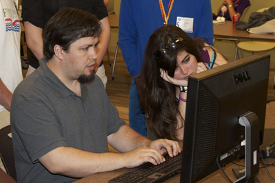 Selena Snyder and Michael Havard work on a mock website