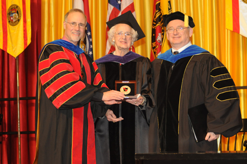 Pictured (from left) are UMSL Chancellor Tom George, Anna Mayer Beck and Joel Glassman