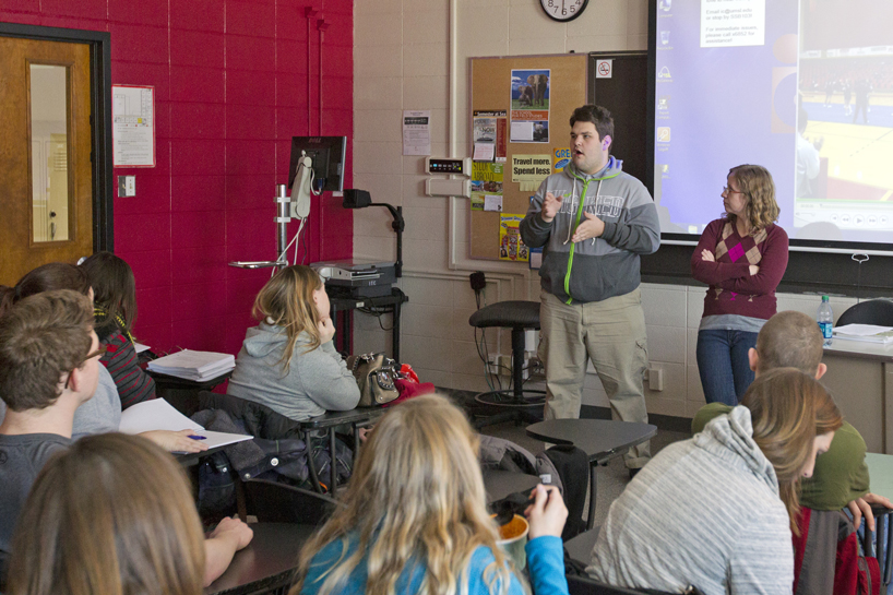 UMSL SUCCEED student Grayson Jostes speaks to his class
