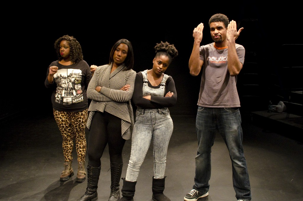 From left, UMSL student Tiffany Knighten, Professor Jacqueline Thompson, student Kenyata Tatum and St. Louis actor Reginald Pierre participate in an exercise during the Theatre of the Oppressed workshop at the Kranzberg Art Center. (Photo by Michael B. Perkins.)