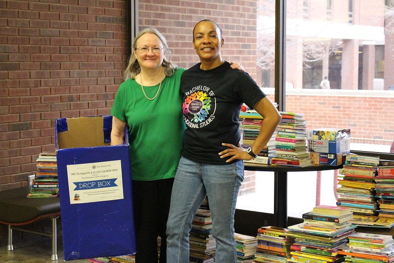 UMSL Phi Kappa Phi promotes literacy at Koch Elementary, wins national book drive