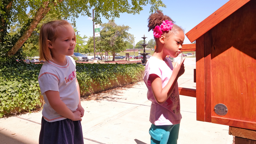 Tiny campus library attracts patrons of all sizes