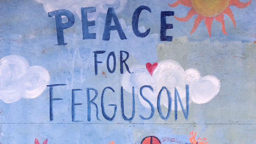 This artwork was one of many artistic expressions painted on the plywood of boarded up businesses on Florissant Road. (Photos by August Jennewein)