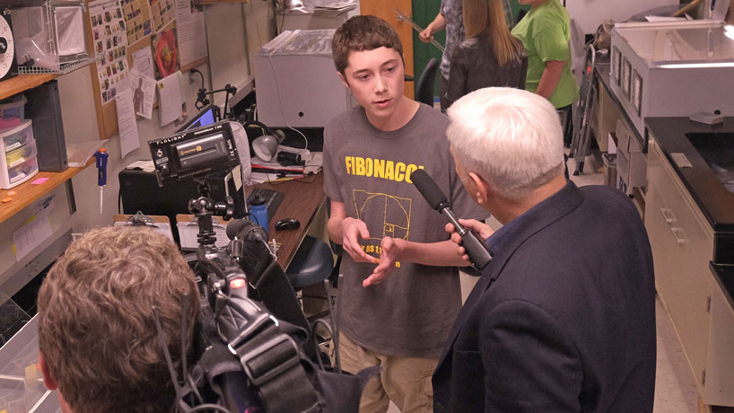 KETC's Jim Kirchherr (right) interviews Parkway Central High School student Lucas Shanker about research he is conducting on bee behavior as part of the 2015 STARS summer program at UMSL. (Photos by August Jennewein)
