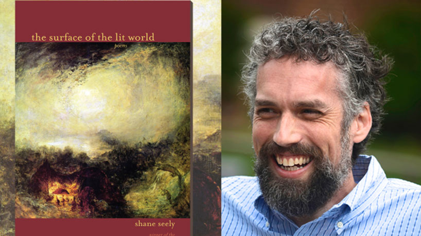"""Assistant Professor Shane Seely's second book """"The Surface of the Lit World"""" won the 2014 Hollis Summers Poetry Prize. He is currently working on his third book while teaching in the MFA in Creative Writing program at UMSL. (Photo by Jennifer Goldring)"""