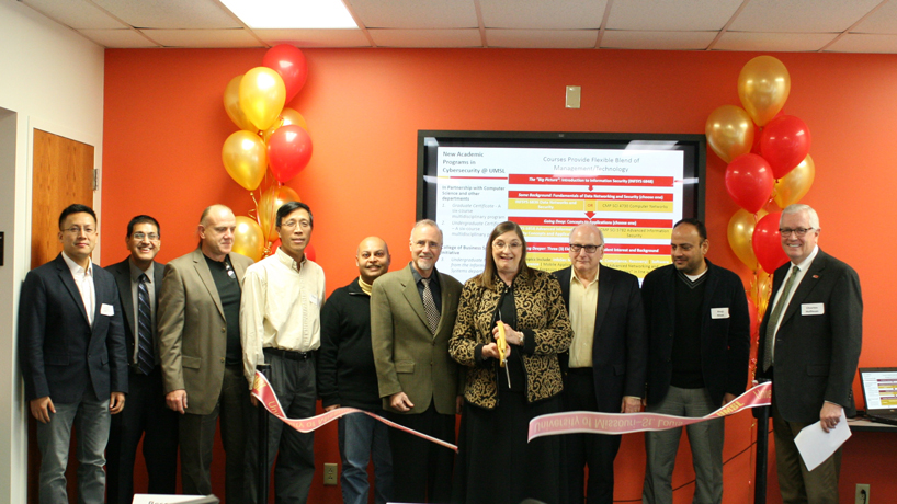 UMSL's Cybersecurity Lab opened Nov. 13 on the second floor of Express Scripts Hall. The lab is a collaboration between the Department of Information Systems and Department of Math and Computer Science. Pictured (from left) are  Jianli Pan, Dinesh Mirchandani, Cezary Janikow, Haiyan Cai, Sanjiv Bhatia, Chancellor Tom George, Provost Glen Cope, Dean Ron Yasbin, Shaji Khan and Dean Charles Hoffman. (Photo by Jen Hatton)