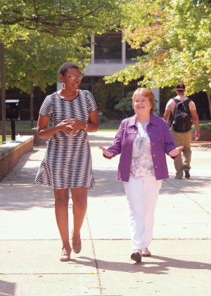 Alumnae Aleshia Patterson (left) and Norma Barr stroll campus as they discuss how the new, all-inclusive Alumni Association membership helps alumni connect to UMSL. (Photo by August Jennewein)
