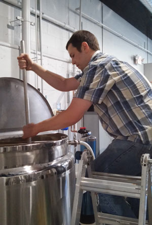 While Nathan Letcher celebrated graduation afar, he brewed one of the first batches of beer to go on tap at Iowa City Brewlab. He's been home-brewing beer for seven years.