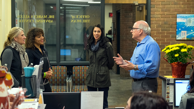Dean Yasbin talks with a prospective student and her mother
