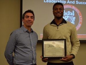 Associate Teaching Professor Marc Spingola (at left), keynote speaker at the Dec. 2 ceremony, stands with Aaron Pelloquin, graduate assistant for Leadership & Training in the Office of Student Life.