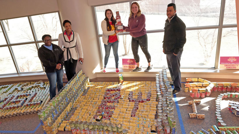 'CANstruction' competitors assemble 10,000 cans for a good cause
