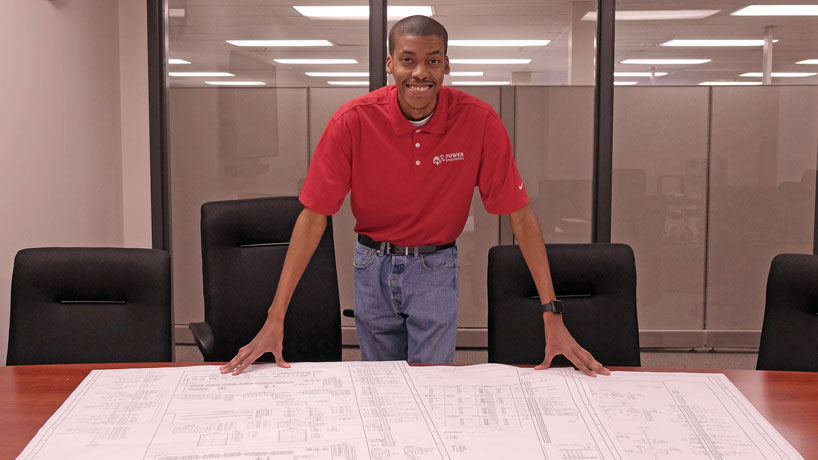 Travis Johnson is an electrical engineer at POWER Engineers, a job he landed after working a co-op position at the company as an engineering student in the UMSL/WUSTL Joint Engineering Program. (Photos by August Jennewein)