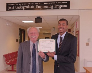 Associate Dean of the UMSL/WUSTL Joint Engineering Program Bernard Feldman and recent graduate Travis Johnson hold up Johnson's IEEE Power & Energy Society Scholarship award. He was the first UMSL student to ever have been selected for the national scholarship.