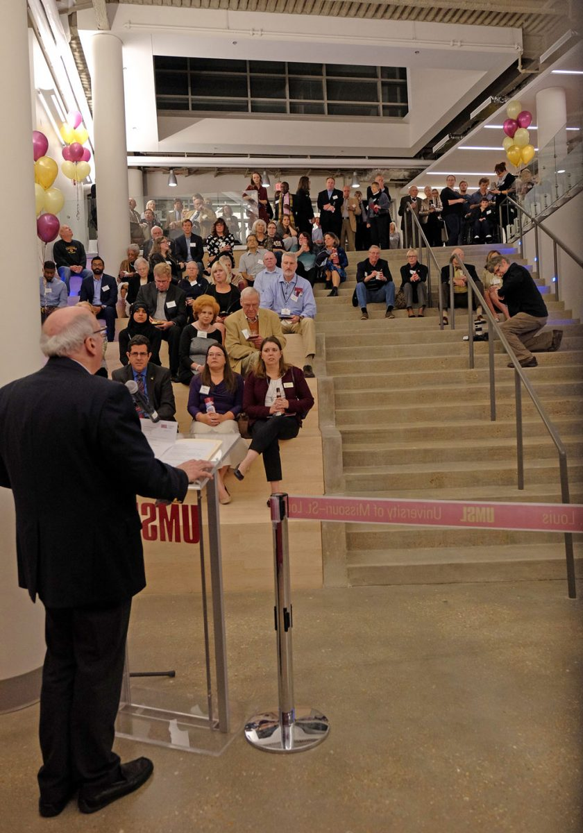 "Nearly 300 attendees of the grand opening poured on to the steps and back into the halls of the new Science Learning Building as College of Arts and Sciences Dean Ron Yasbin addressed the crowd in the solarium area of the ""Town Center,"" which connects the SLB to Benton and Stadler halls, forming the science complex."