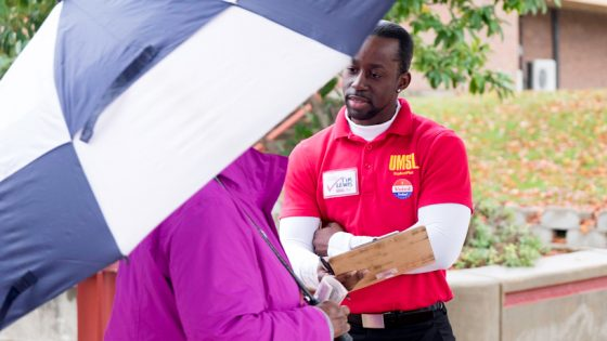 Doctoral student Tim Lewis asks a voter if she will complete an exit-poll survey at the Dellwood Recreation Center. Lewis estimated that he and fellow students had a 50-percent success rate getting voters to participate in the project.