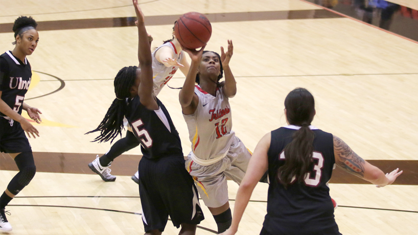 Robneisha Lee puts up an off-balance shot between Southern Indiana defenders