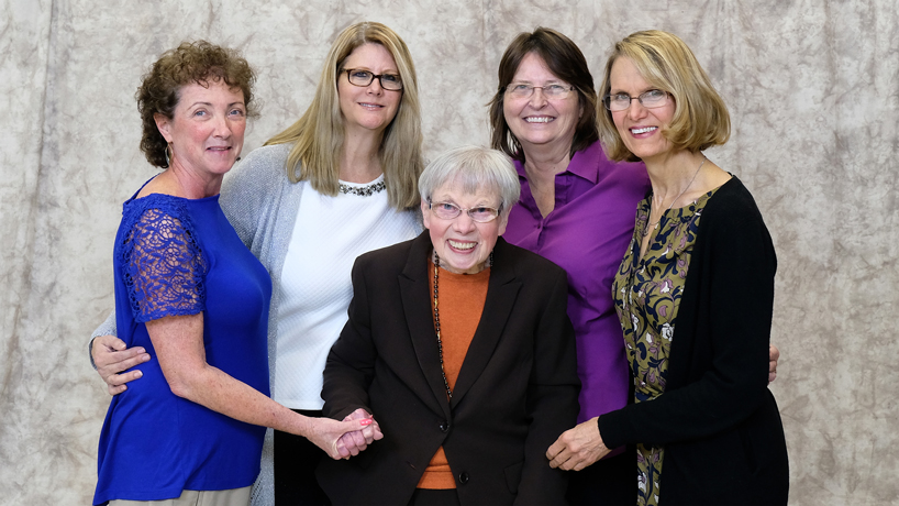 Professor Emerita of Chemistry Jane Miller (center) stands with former students and UMSL alumnae (from left) Jeanette Hencken, Liz Petersen, Sandra Mueller and Joan Twillman. The women credit Miller with inspiring them to pursue careers in science education and instill their passion for science and women empowerment in generations of St. Louis youth. (Photo by August Jennewein)
