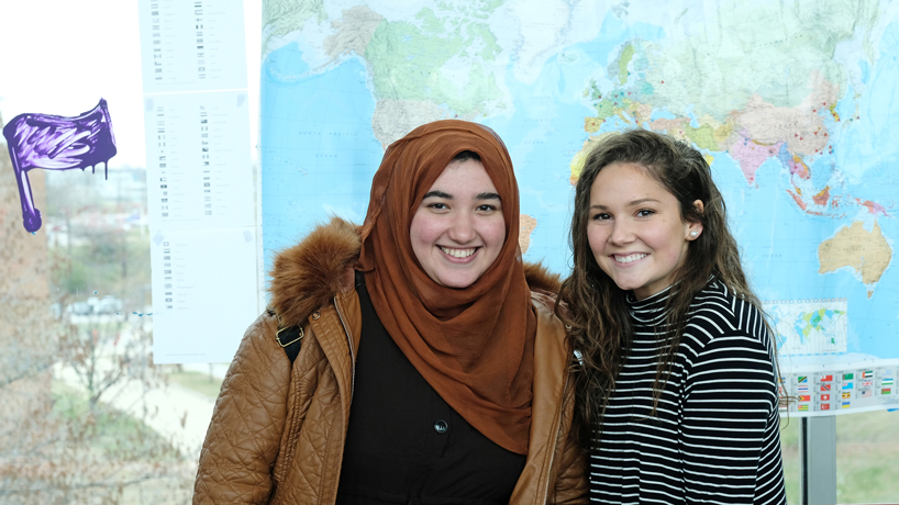 Brick by brick, UMSL students build bridge of support for international community
