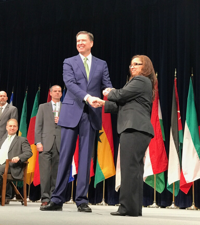 James Comey and Marisa Smith shaking hands