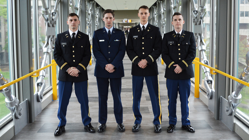 Along with their UMSL degrees, ROTC cadets (from left) Lucas Elberfeld, Jared Dillmon, Steven Galbraith and Andrew Potts are earning their officer stripes. Together with fellow graduate and cadet Katie Kluthe (not pictured), they comprise UMSL's largest commissioning class in over a decade. (Photo by Evie Hemphill)