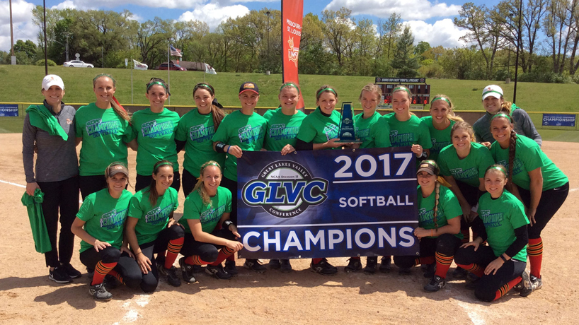 UMSL softball team posing together after winning 2017 GLVC Tournament title