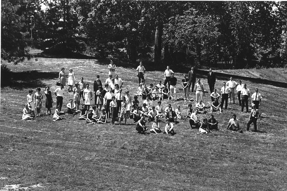 The class of 1967 takes a break from their graduation rehearsal on the hillside of Bugg Lake at UMSL. Click on the photograph to zoom in on a larger version of the image.