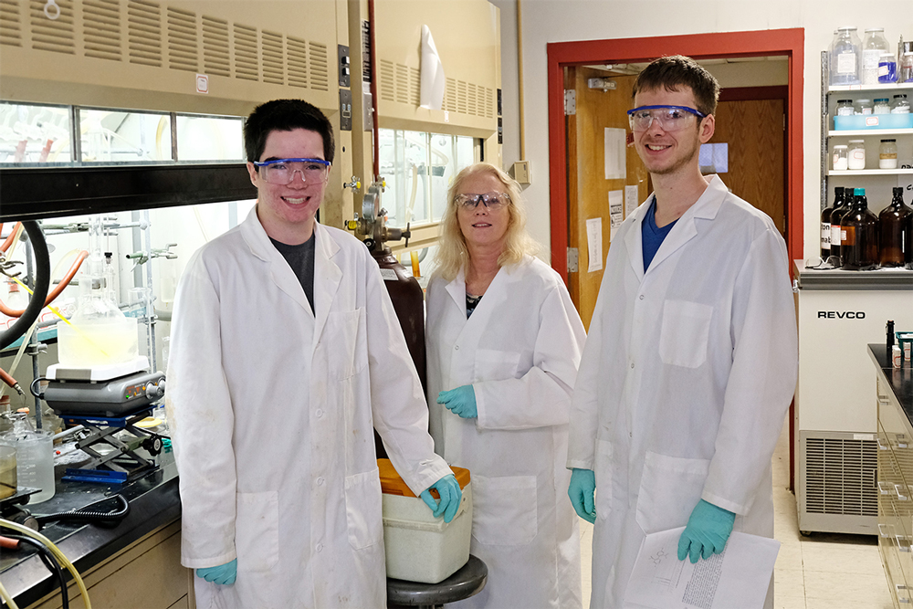 Both Wilking (center) and Skaggs (at right), along with a doctoral student and two undergraduate researchers in the lab, have served as mentors to Willis, who is gaining research experience through the STARS program the summer before his senior year of high school at Westminster Christian Academy.