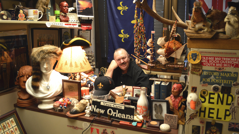 Fred Fausz in his artifact-filled office