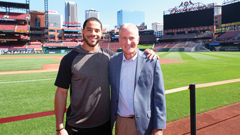 St. Louis Cardinals outfielder Tommy Pham relies on Dr. Ed Bennett, a UMSL optometrist, to help monitor his vision and fit his contact lenses after Pham underwent a procedure for keratoconus. (Photo by August Jennewein)