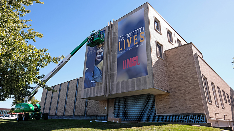 New 'We Transform Lives' mission statement on display on university buildings