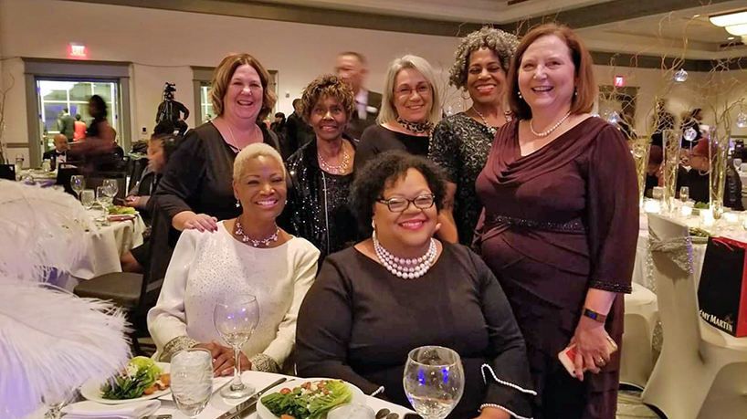 During its annual gala on Saturday, the 100 Black Men awarded Assistant Professor Sheila Grigsby its Pillar Award for Health and Wellness. (bottom row from right) Sheila Grigsby and Theda Oliver. (top row from right) Dean Susan Dean-Baar, Associate Professor Wilma Calvert, Donald L. Ross Endowed Chair for Advancing Nursing Practice Roxanne Vandermause, Instructor Gwendolyn Stubblefield and Assistant Teaching Professor Beth Dudley.