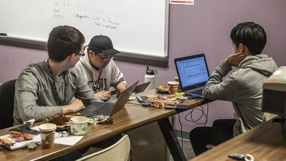 """I really enjoy just creating something, working with my friends and making something that's not part of a class,"" said WUSTL student Hyunrae Kim. Kim (from left) along with Joel Ki and Shane Blair created WUSTL crime report data visualizations. (Photo by Jessica Rogen)"