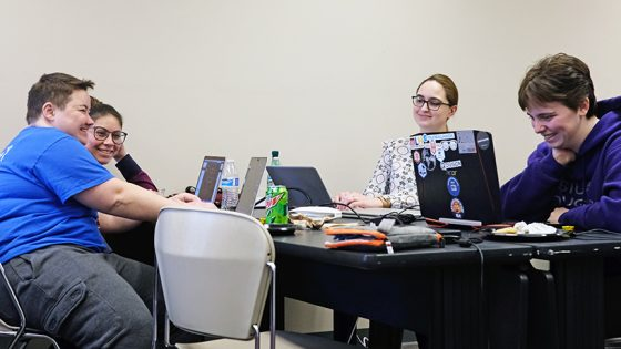 "Team Women Hack created a Tinder-inspired app pairing nonprofit organizations with volunteers – a ""Volun-tinder."" From left: Nicole Gaehle and Karina Almeida were programming, Emily Koehler was project manager and Southern Illinois University Edwardsville student Jami Howell created their database. (Photo by Jessica Rogen)"