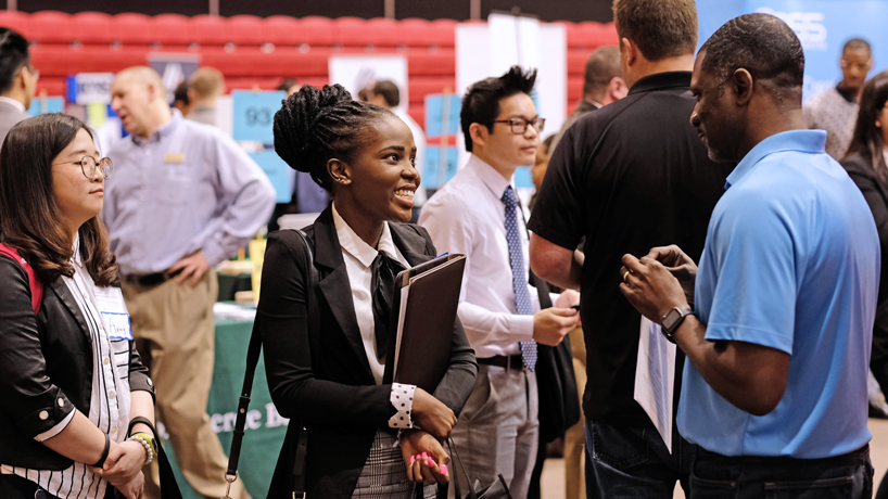 Face time: Students mingle with and try to impress potential employers at Spring Career Fair