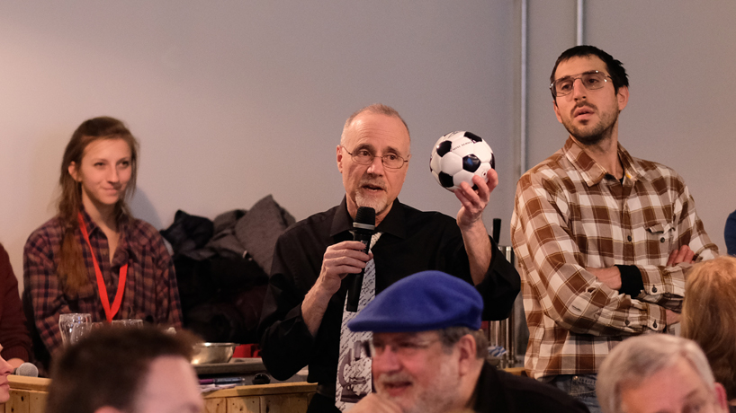 Chancellor Tom George discusses 'Soccer Balls from Outer Space' during Astronomy on Tap event