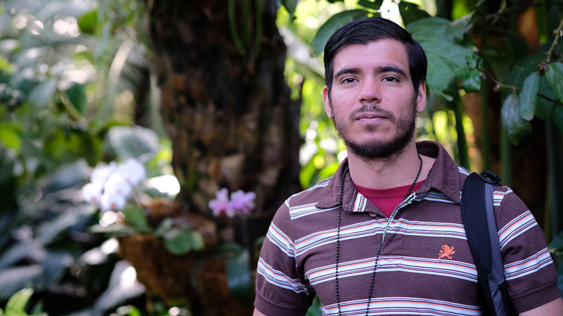 Doctoral student Juan Moreira-Hernández researching bat-pollinated tropical plants and sharing love of biology
