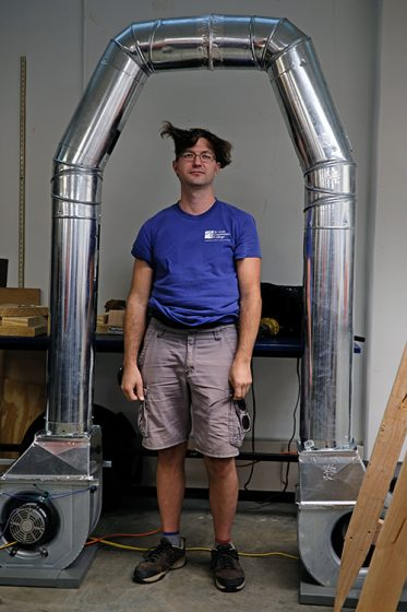 Nickaleous Zuelke modeled the functionality of his group's project, a full-body dryer.