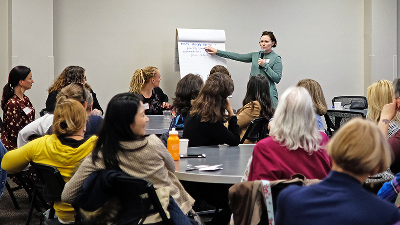 Associate Professor of Psychological Sciences Bettina Casad shares her tables' ideas at the inaugural meeting of the Women's Faculty Network on Wednesday. (Photos by Mona Sabau)