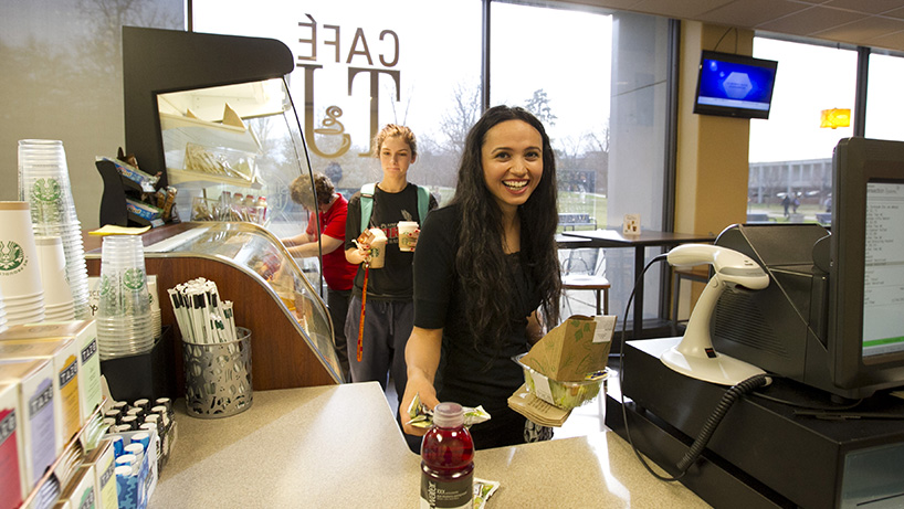 Explore campus hangouts such as Cafe TJ in the library during UMSL Day.