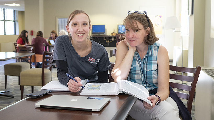 Mother and daughter Kristin and Clare Vogt were caught in a rare moment of studying together. Though they are both College of Nursing BSN students, one is in the traditional and the other is in the accelerated program, which means they don't take the same classes. (Photo by August Jennewein)