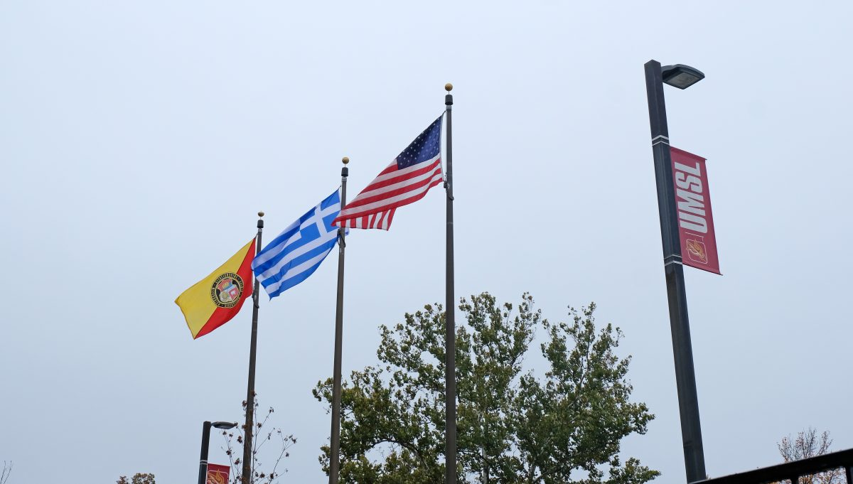Greek flag in front of Woods Hall