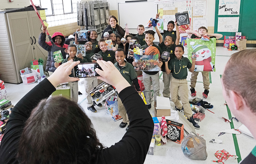 College of Optometry brings Christmas to south city charter school
