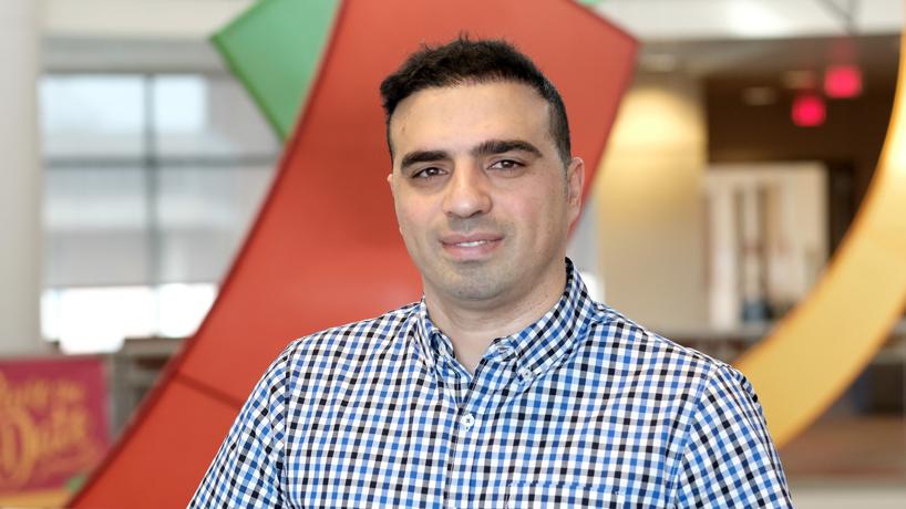Former Green Card Lottery winner Ehsan Davarzany earns master's degree in economics
