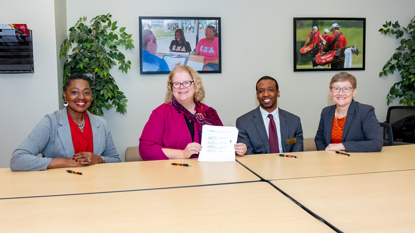 UMSL formalizes partnership with Wyman to support students from disadvantaged circumstances
