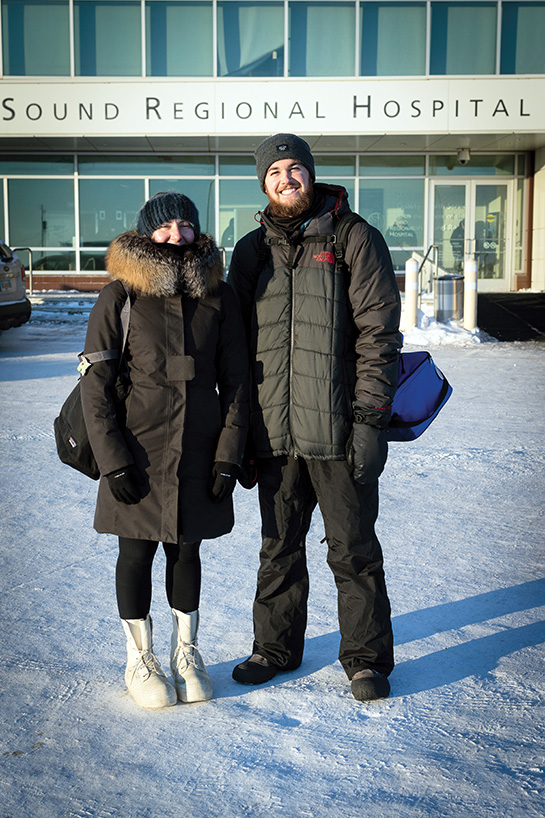 Marcy O'Neil (left) and George Dowdy stand in front of the eye clinic at Norton Sound Regional Hospital in Nome, Alaska. (Photo by Michael Burnett)