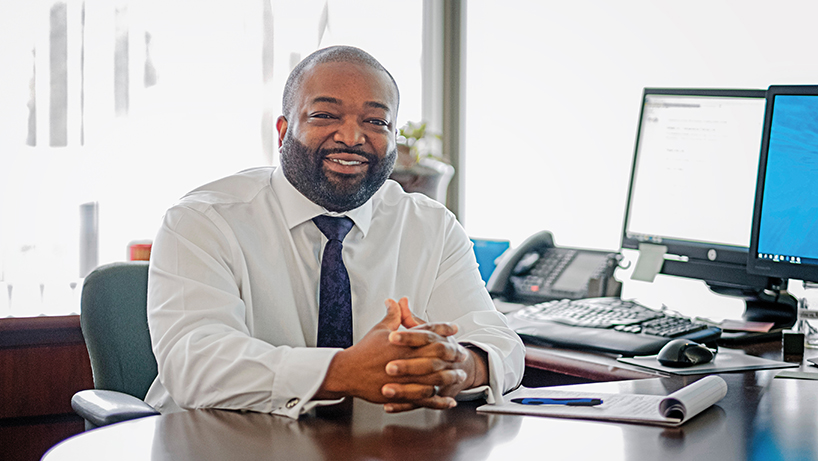 College of Business alumnus Aaron Ezell is now a financial advisor with Edward Jones. (Photo by August Jennewein)