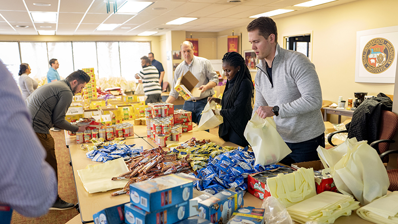 Alumni and Edward Jones employees boxed food donations for the Triton Pantry