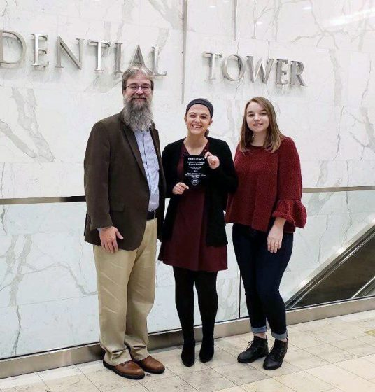 From left: Director of Student Services and Alumni Relations and Associate Teaching Professor Dan Gerth, former Brain Stew Editor Nicole Gevers and current Editor Sammy Jacobs accepted a third place award in Boston's Prudential Tower (Photo courtesy of Sammy Jacobs)