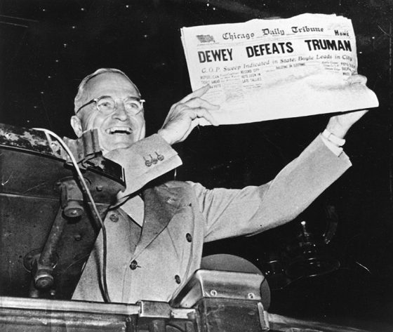"""In this St. Louis Globe-Democrat photograph, a triumphant President Harry S. Truman holds up the Chicago Daily Tribune on Nov. 3, 1948 during a stop at St. Louis Union Station to display the famously erroneous """"Dewey Defeats Truman"""" headline. The paper misjudged the outcome of the presidential election and declared Thomas E. Dewey the winner."""