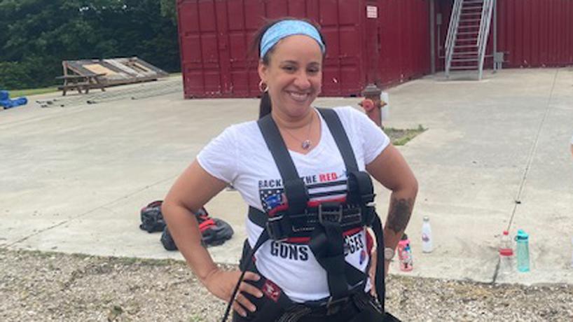 Mariah Thomas standing at Camp Fury